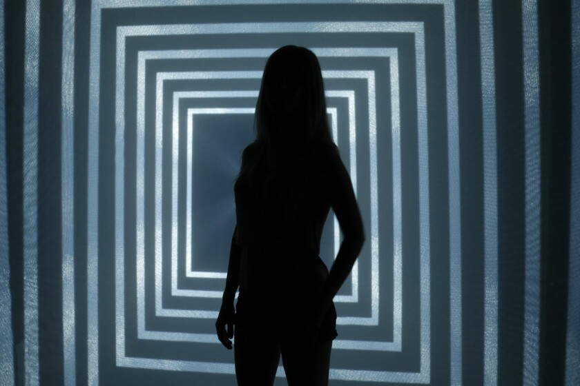 Blind dater Sarah Sharples is silhouetted in front of the art installation called Daydream v2 at Wonderspaces in Mission Valley.