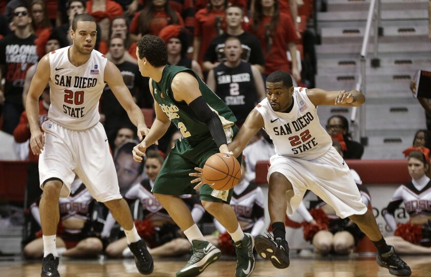 Chase Tapley (right) steals the ball from Colorado State's Dorian Green in overtime, then takes the ball in for a layup.