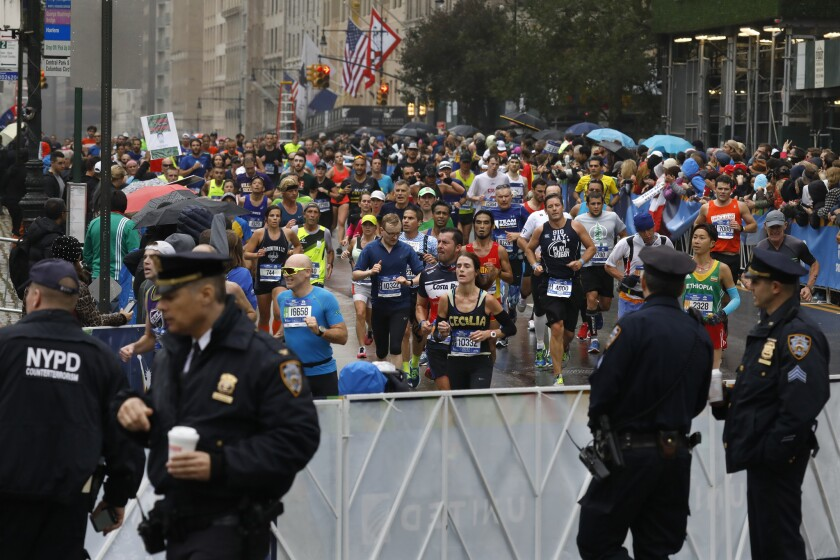 New York City police at Columbus Circle as runners approach the marathon finish line.