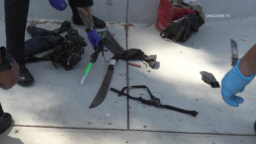 A machete and other items seized by police