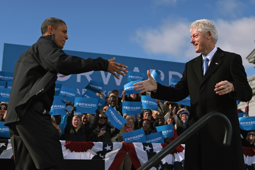 A comparison of presidents: Bill Clinton is popular and President Obama is far less so in a new Wall Street Journal poll. Above, the two campaigned together in Concord, N.H., in 2012.