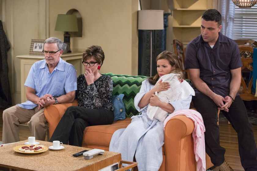 The family gathers around the television in 'One Day at a Time's' 9/11-themed episode