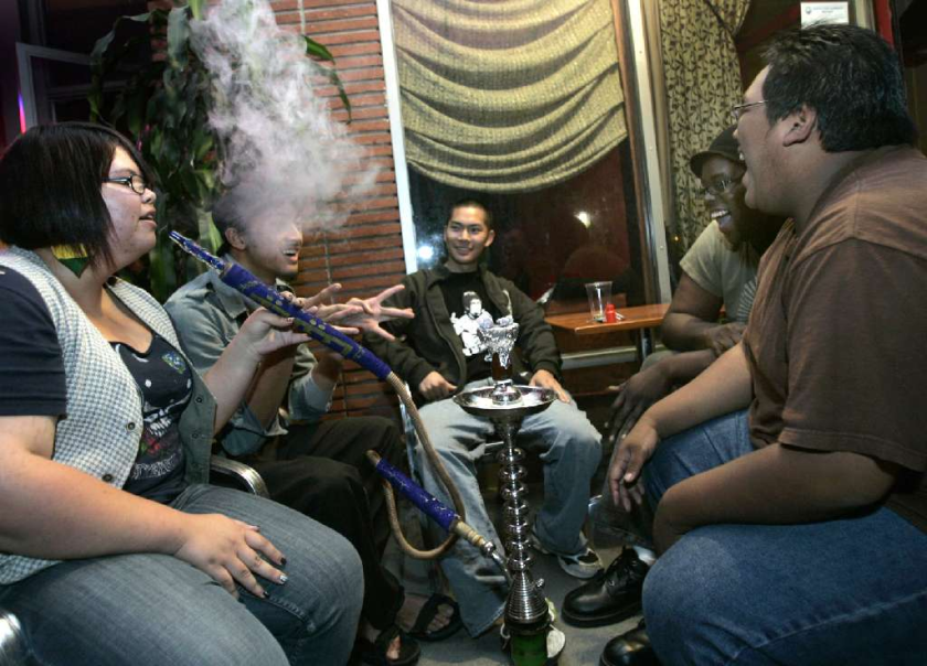 Friends share a water pipe at a hookah lounge in Long Beach. A study found that 18% of American high school seniors had used a hookah at least once in the preceding 12 months.