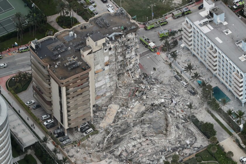 A partially collapsed building is seen early Thursday.
