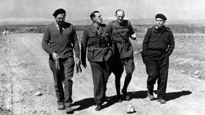 Ernest Hemingway, left, and Joris Ivens, right, working on their documentary about the Spanish Civil War.