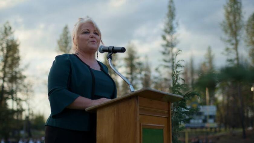 """Michelle John addresses Paradise High School graduates in a scene from the documentary """"Rebuilding Paradise."""""""