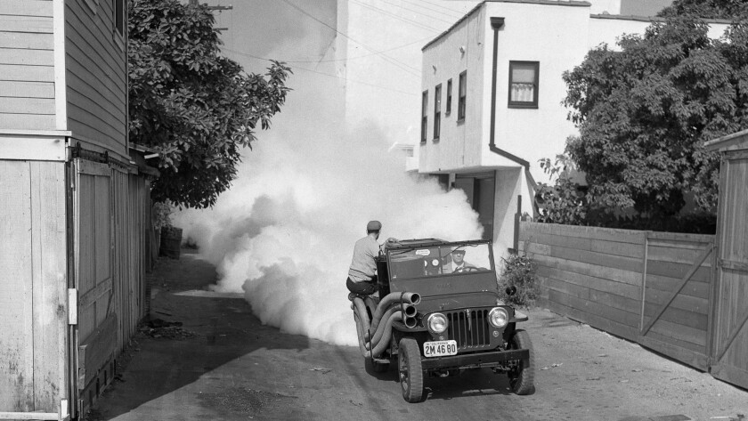 In November 1948, a crew sprays a solution of DDT in a Santa Monica alley following an outbreak of polio.