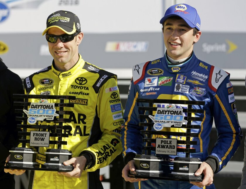 Matt Kenseth, left, and Chase Elliott hold their trophies after they qualified for the top two starting positions in the NASCAR Daytona 500 auto race at Daytona International Speedway, Sunday, Feb. 14, 2016, in Daytona Beach, Fla. (AP Photo/John Raoux)
