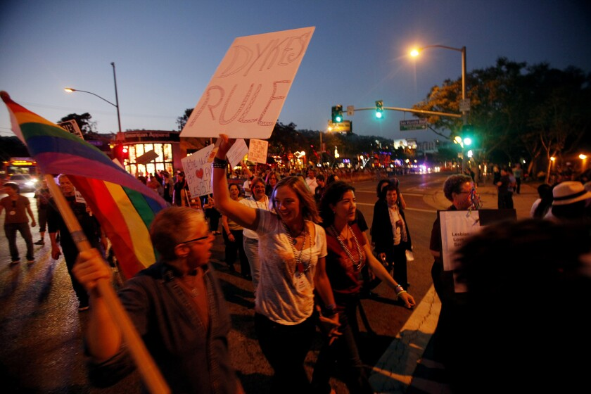 People participate in The Annual WeHo Dyke March on Santa Monica Boulevard in West Hollywood in 2012.