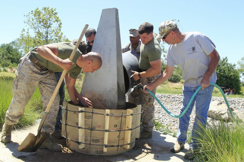 Feed The Dawgz co founder Jon Hemp (right) works with volunteers building a memorial to United States Military War Dog Handlers at Camp Pendleton.