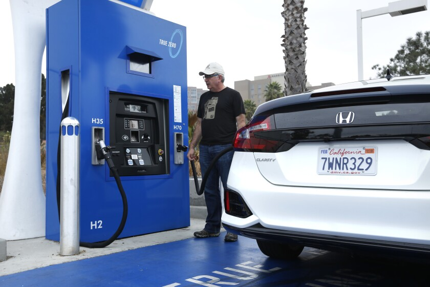 The owner of a Honda Clarity, a hydrogen fuel cell car, fills up his tank at the Shell station near Del Mar in November 2017. The San Diego area's second fueling station is expected to open in the coming months.
