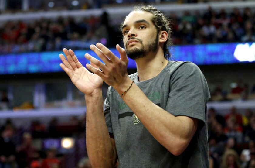 Joakim Noah applauds a teammate's effort during his days with the  Chicago Bulls.