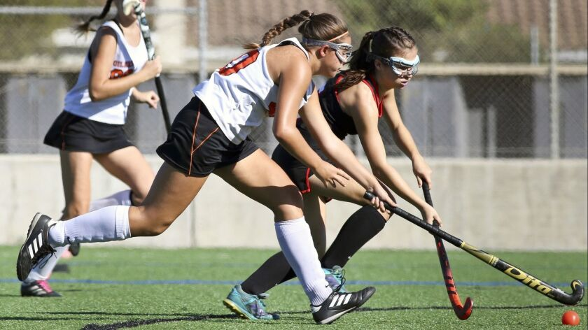 Players pursue the ball in the Los Angeles Field Hockey Assn. Tournament of Champions final on Satur