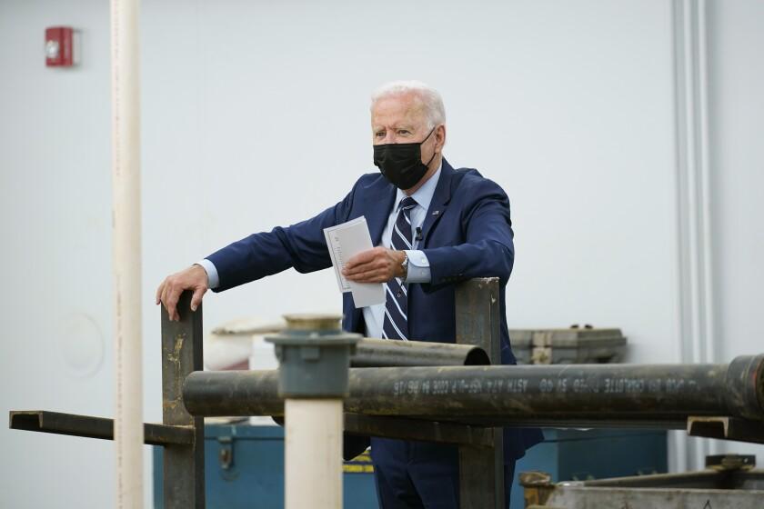 President Joe Biding tours Plumbers & Gasfitters Local 5 Training Facility in Lanham, Md., Wednesday, Aug 4, 2021. (AP Photo/Susan Walsh)