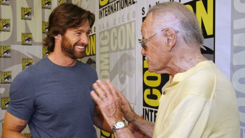 Hugh Jackman, left, talks to the late Stan Lee in 2008 at San Diego Comic-Con International.
