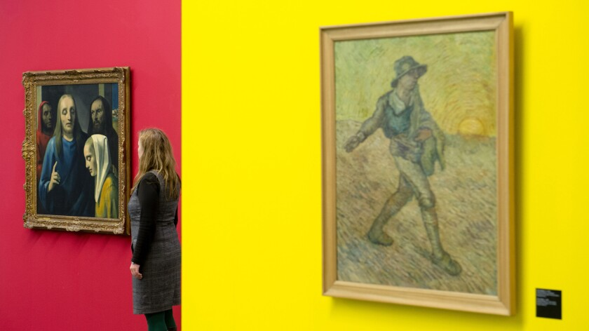 A woman looks at a painting by forger Han van Meegeren which he sold as Jan Vermeer's painting Christ and the Adultress. Also pictured is a forgery of Vincent van Gogh's painting The Sower by Leonhard Wackerforger at a 2014 exhibition of fakes at Moritzburg art museum in Germany. Image from the book 'The Art of the Con' by Anthony M. Amore.