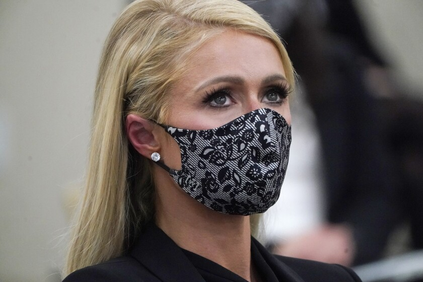 Paris Hilton looks on after speaking at a committee hearing at the Utah State Capitol, Monday, Feb. 8, 2021, in Salt Lake City. Hilton has been speaking out about abuse she says she suffered at a boarding school in Utah in the 1990s and she testified in front of state lawmakers weighing new regulations for the industry. (AP Photo/Rick Bowmer)