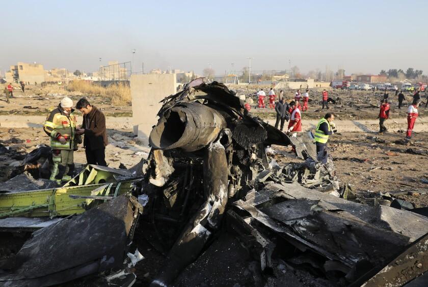 Debris at the scene where a Ukrainian plane crashed in Shahedshahr southwest of the capital Tehran.