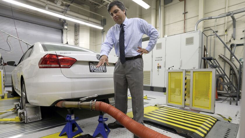 California Air Resources Board spokesman John Swanton shows how a Volkswagen Passat with a diesel engine is evaluated at an emissions test lab in El Monte in 2015.