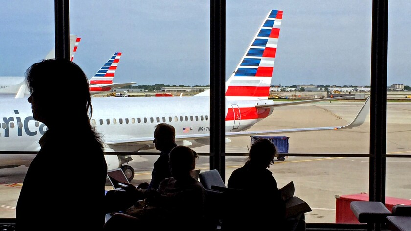 The average domestic airfare this fall is forecast to be $248, or 3.6% cheaper than in fall 2014. Above, travelers at Chicago O'Hare International Airport.