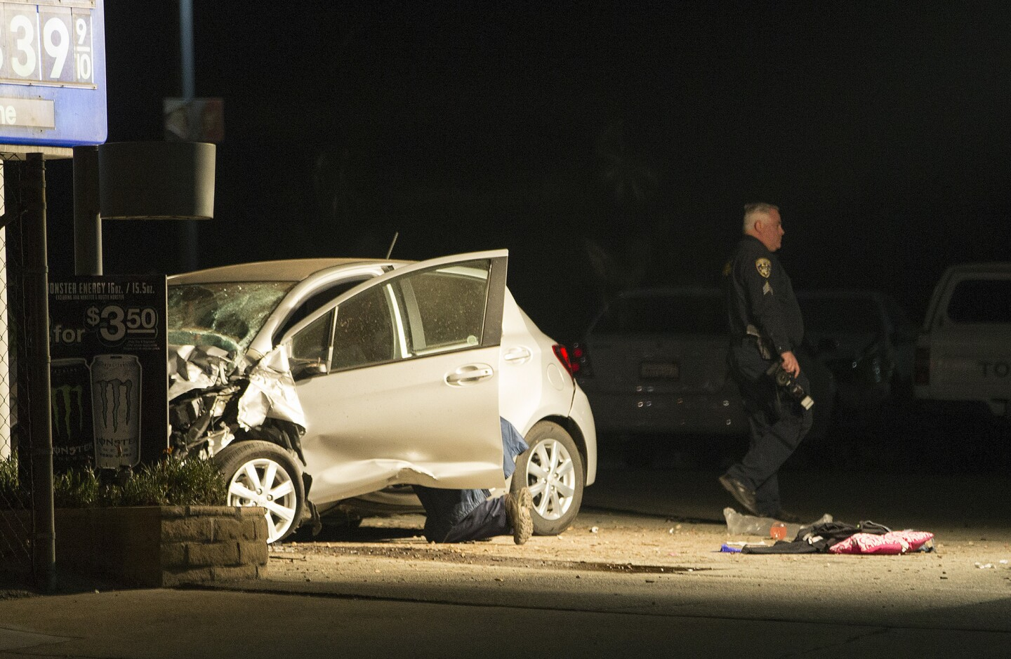 Ontario police investigate the scene of a two-car crash that left five dead Thursday.