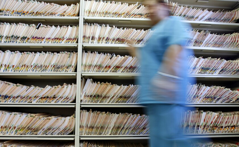There's a growing national effort to bring medical records into the digital age by converting the paper records now scattered in doctors' file cabinets to electronic records.
