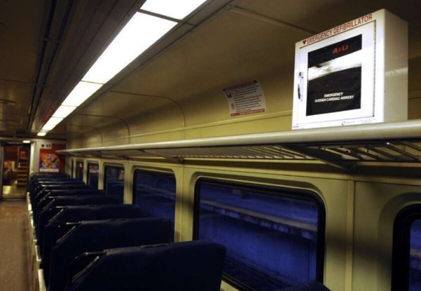 The FDA has proposed new rules aimed at improving the safety and reliability of automated external defibrillators, like this one on a commuter train near Boston. AEDs treat patients suffering from sudden cardiac arrest by shocking the heart back into a normal rhythm.