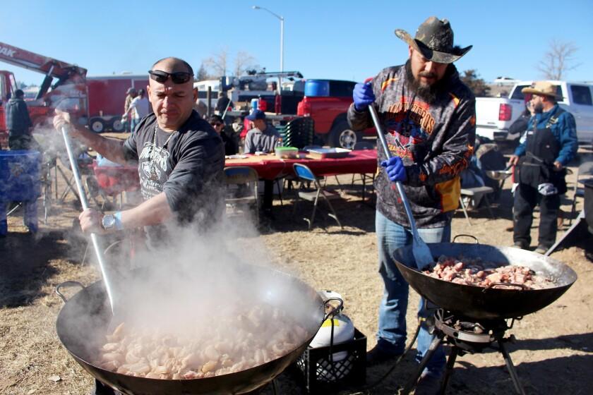 Members of the Rio Grande Matanzeros prepare chicharrones to serve at the World's Largest Matanza.