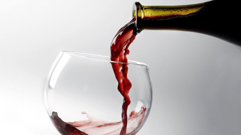 McKoy, Kirk -- B58753520Z.1 Stock wine photo of a glass of red wine being poured from teh bottle.s