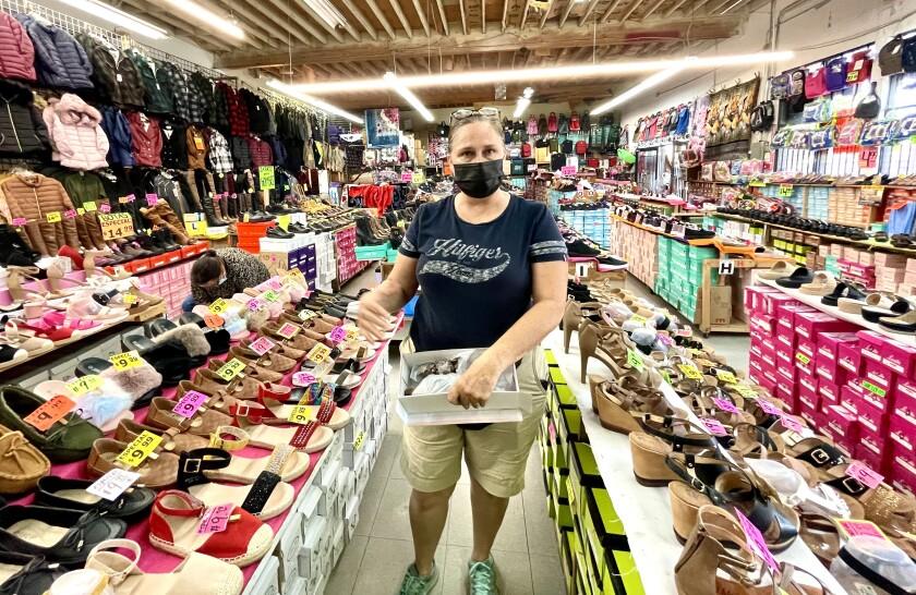Olivia Campos, owner of Carolin Shoes on San Ysidro Boulevard.