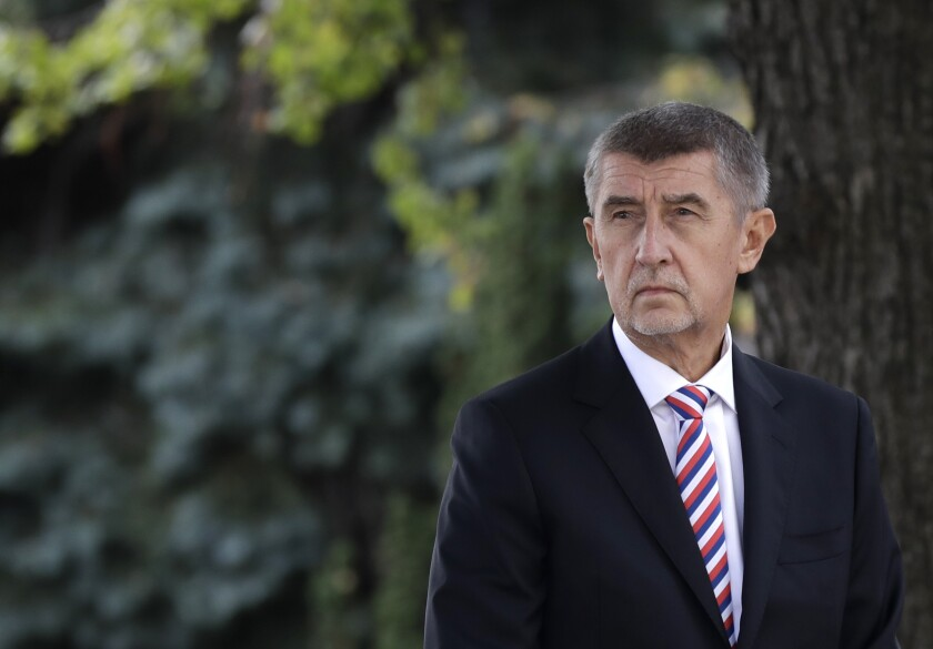 FILE - In this Oct. 26, 2018 file photo Czech Republic's Prime Minister Andrej Babis waits in front of his residency in Prague, Czech Republic. On Wednesday, Dec. 4, 2019, the Czech Republic's prosecutor general has overturned a previous decision by the prosecution to drop charges against Czech Prime Minister Andrej Babis over alleged fraud involving European Union subsidies. (AP Photo/Petr David Josek, File)