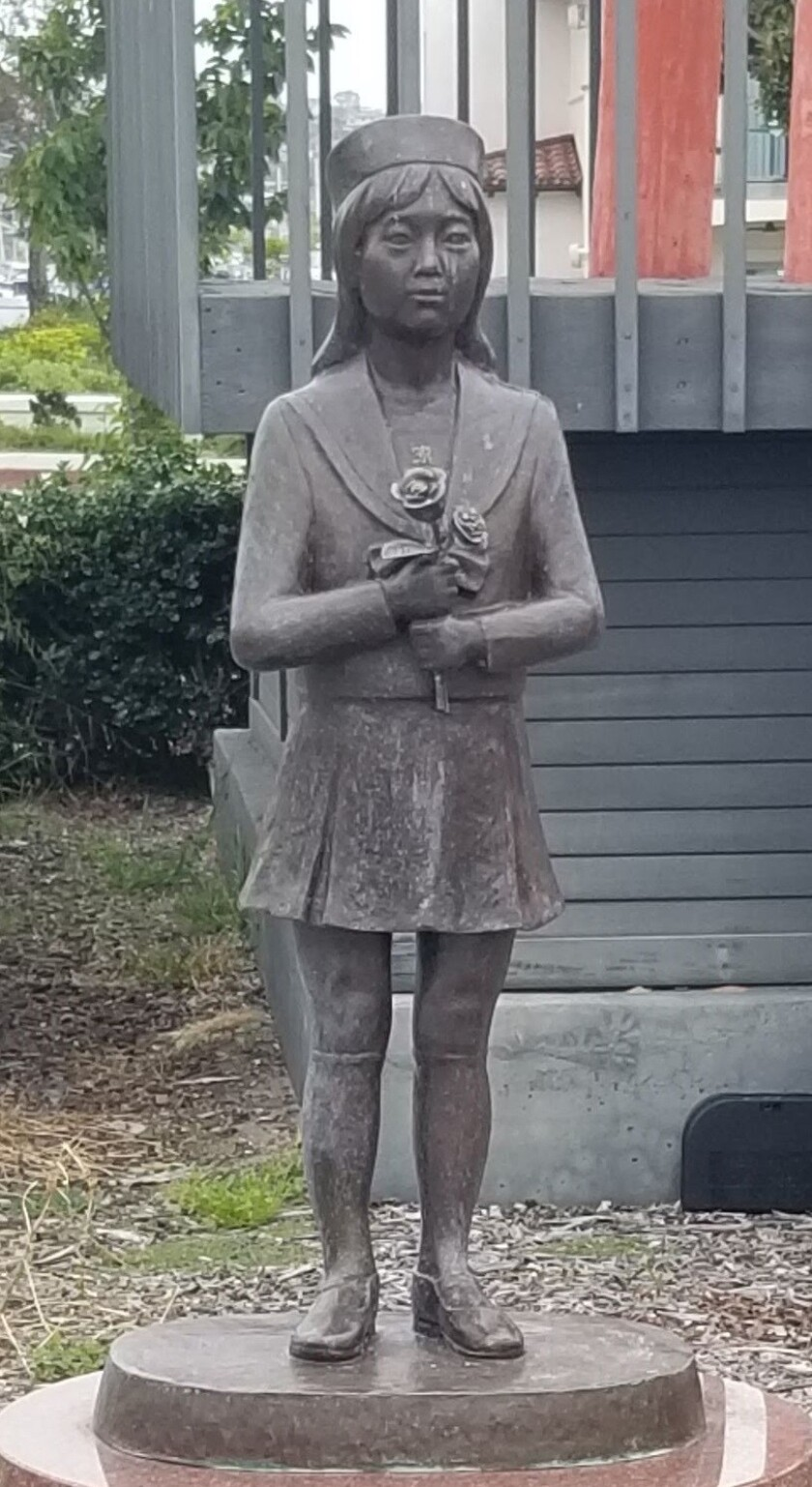 This bronze by artist Munehiro Komeno was presented to the citizens of San Diego by the same Japanese city that presented San Diego with the bell (top right). The sculpture represents eternal friendship and commemorates the 150th anniversary of the Japanese city's port opening. (Answer: Girl in Red Shoes)