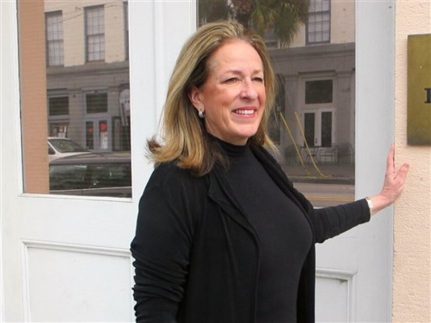 Elizabeth Colbert Busch poses outside her campaign headquarters in Charleston, S.C., on Wednesday, Feb. 13, 2013. The sister of comedian Stephen Colbert is one of two Democrats seeking South Carolina's vacant 1st District congressional seat. There are 16 Republicans in the race. (AP Photo/Bruce Smith)