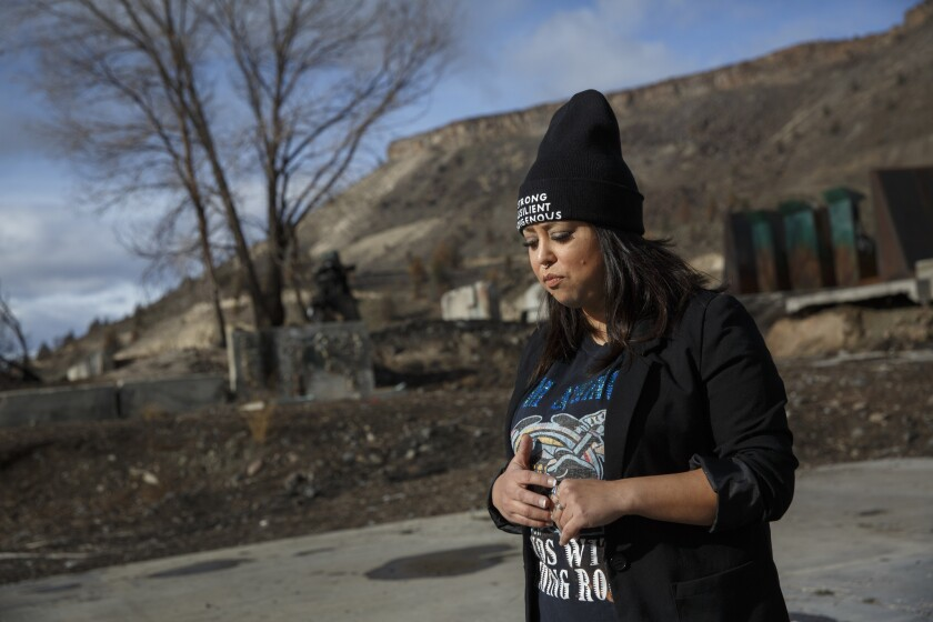 Carina Miller, a tribal council member, stands where Warm Springs Forest Products Industries was located. The lumber mill closed in 2016.