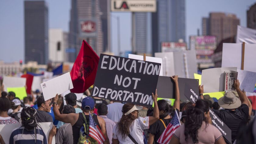 Thousands of immigrants and supporters joined the Defend DACA March in Los Angeles in September to oppose President Trump's order phasing out protections for young people brought to the country illegally as children.