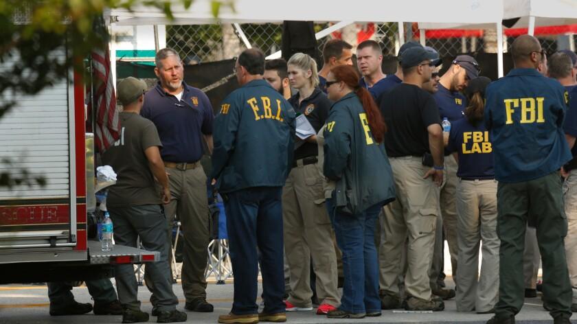 FBI investigators gather Monday morning outside the Pulse nightclub.