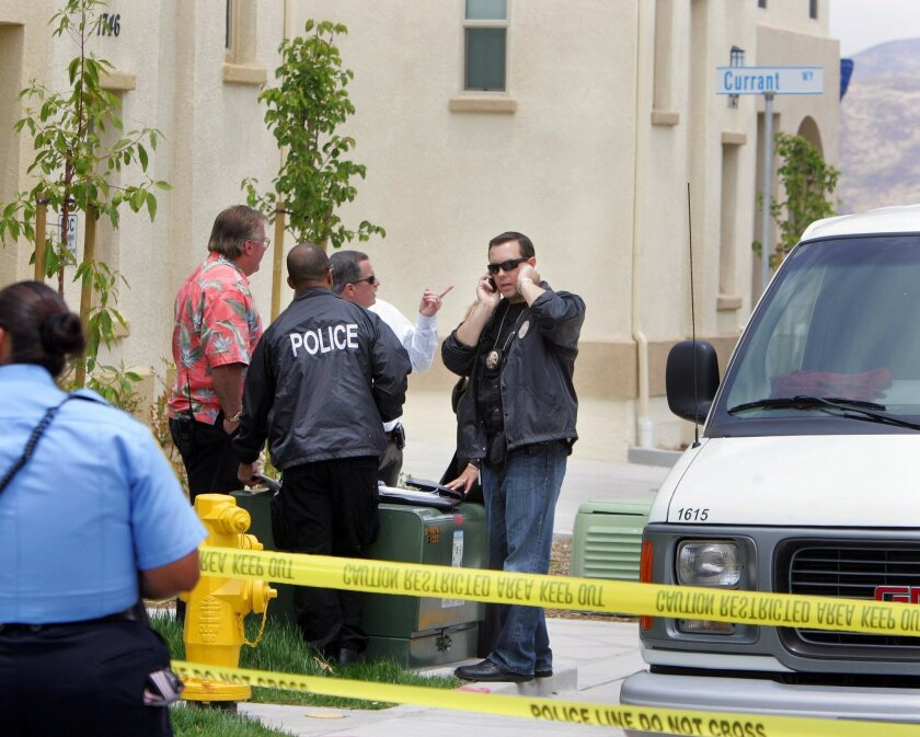 Investigators work at the scene of what police say may be a murder-suicide on Wednesday in Chula Vista.