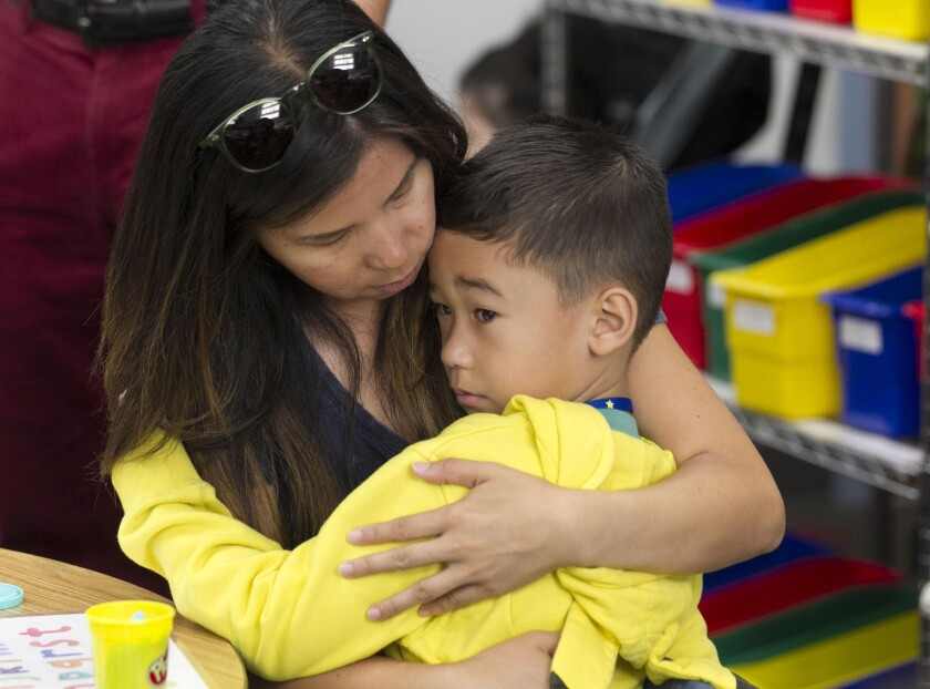 Lorena Taylor comforted her son, 5-year-old Kaleb Taylor on his first day of kindergarten on August 25th, at Zamorano Elementary School in the Bay Terrace community of San Diego.