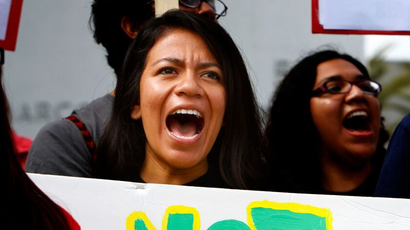 UCLA student Yesenia Capellino lends her voice during a rally for the Dream Act on the lawn of Marco Antonio Firebaugh High School in Lynwood on July 28, 2011.