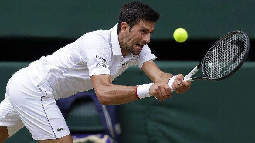 Serbia's Novak Djokovic returns to Spain's Roberto Bautista Agut in a Men's singles semifinal match