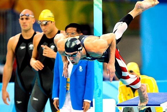 Michael Phelps begins the first leg of the 400-meter freestyle relay.