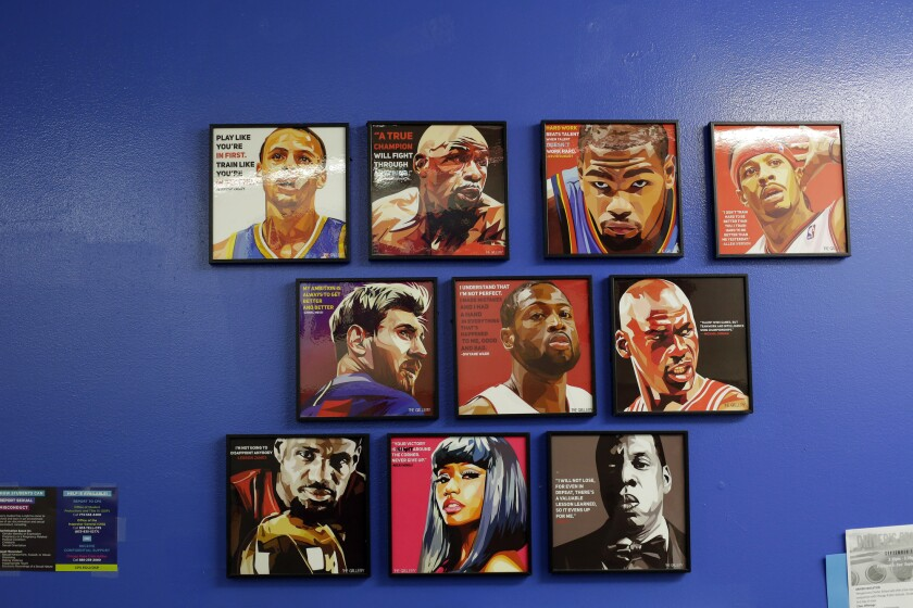 Portraits of athletes and entertainers on a wall at Perspectives Charter Schools'  Joslin Campus.