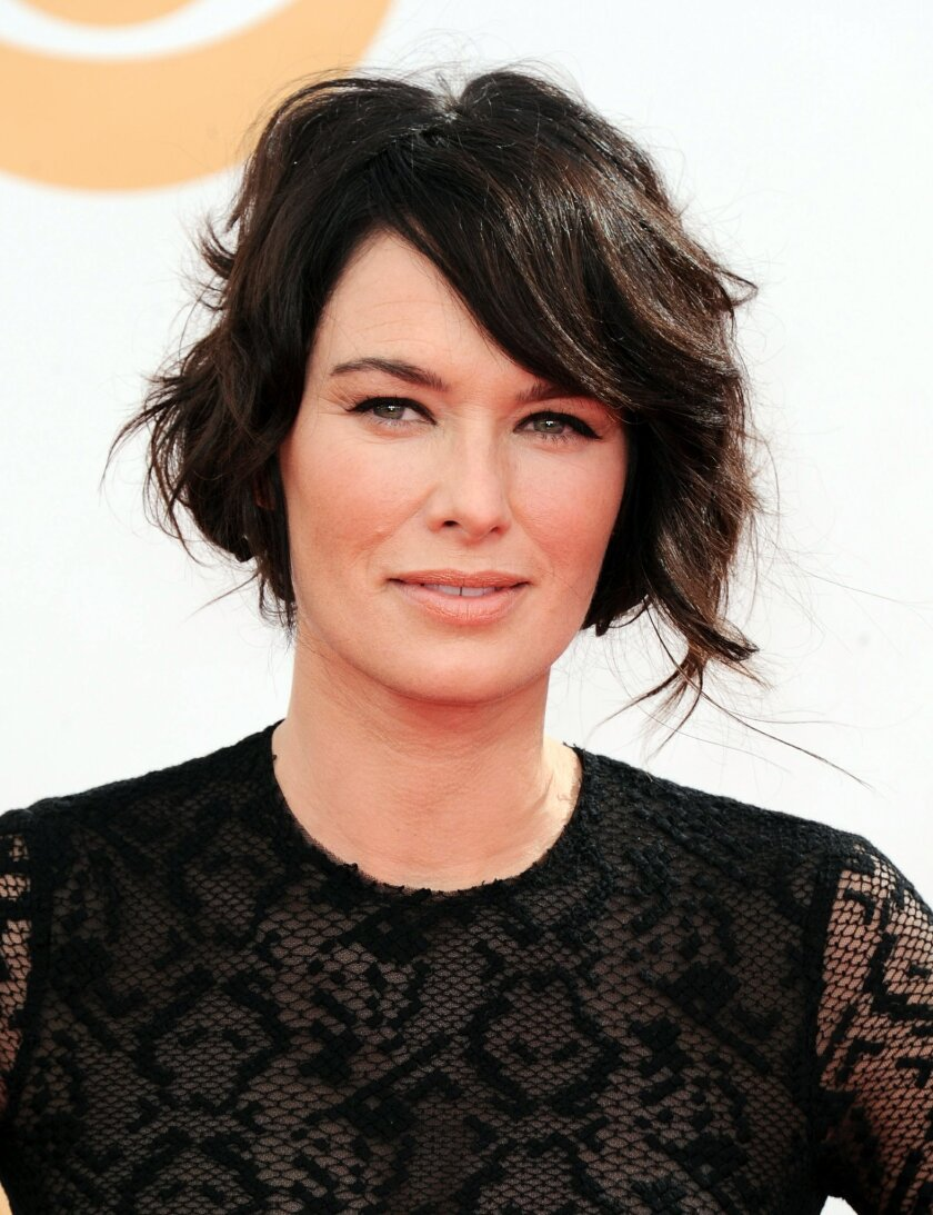 """FILE - In this Sept. 22, 2013 file photo, Lena Headey arrives at the 65th Primetime Emmy Awards at Nokia Theatre in Los Angeles. Headey is not only appearing in the upcoming film version of A.J. Albany's """"Low Down,"""" she's narrating the audiobook. (Photo by Jordan Strauss/Invision/AP)"""