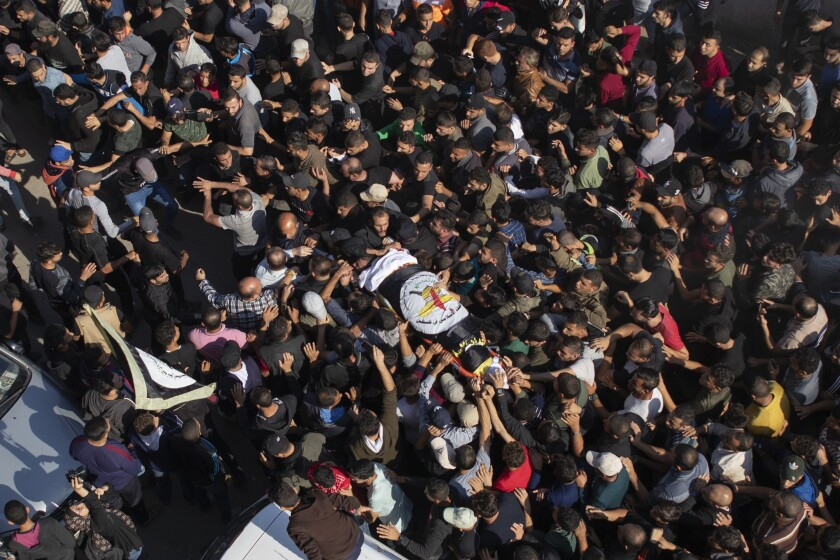 Palestinians chant angry slogans as they carry the body of Islamic Jihad commander, Bahaa Abu el-Atta, killed with his wife by an Israeli missile strike on their home, during his funeral in Gaza City, Tuesday, Nov. 12, 2019. (AP Photo/Khalil Hamra)