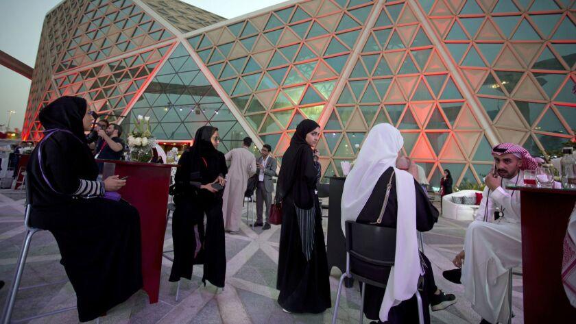 Moviegoers wait to attend an invitation-only screening, at the King Abdullah Financial District Thea