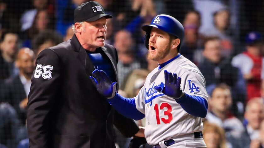 Dodgers pinch-hitter Max Muncy reacts after being called out on strikes by umpire Ted Barrett in the seventh inning against the Chicago Cubs on Tuesday in Chicago.