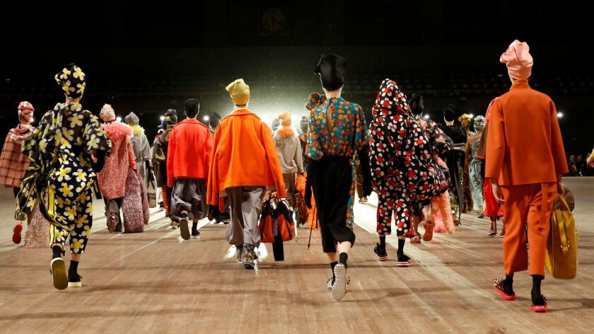 Models depart the runway em masse at the conclusion of the Marc Jacobs 2018 Spring/Summer fashion sh