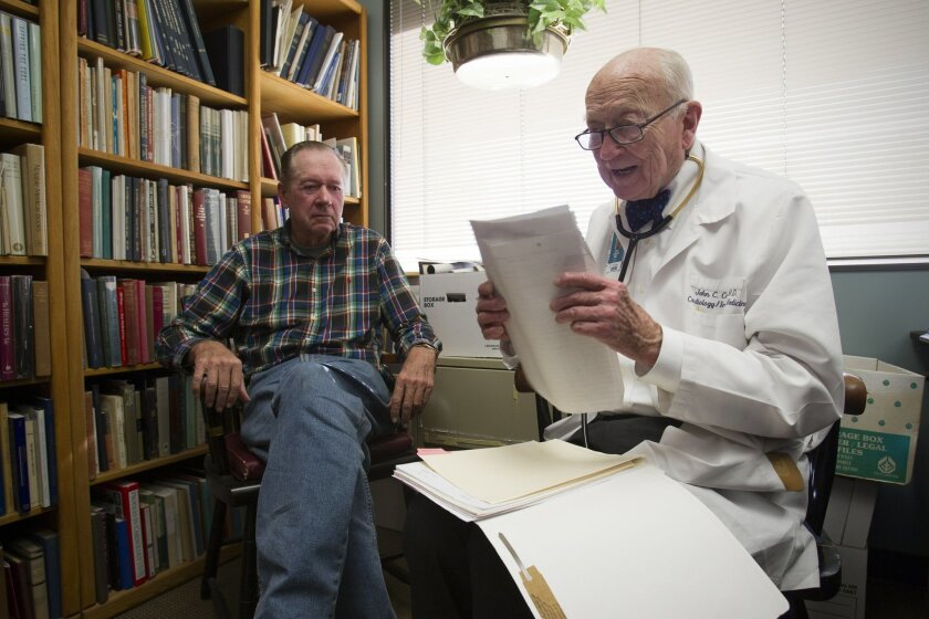 Many of Dr. John Carson's patients have spent decades in his care. Robert Wineteer, left, first came to Carson in 1987.