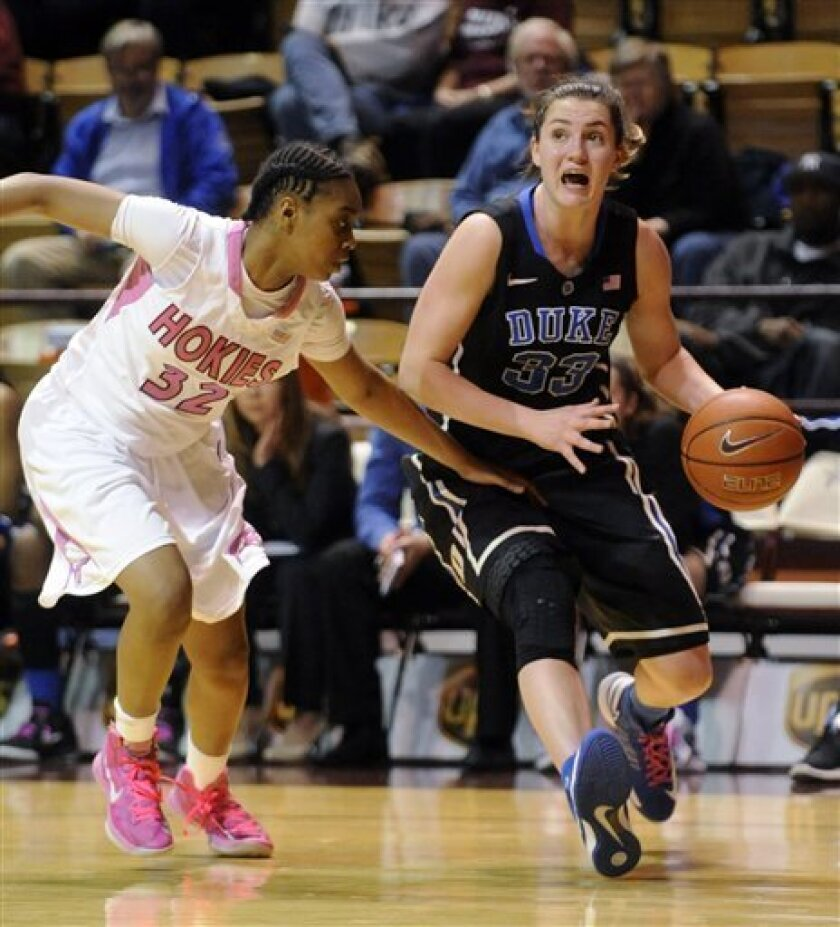 Duke's Haley Peters (33) drives on Virginia Tech's Alexis Lloyd (32) during the second half of an NCAA college basketball game Thursday, Feb. 14, 2013, at Cassell Coliseum in Blacksburg, Va. (AP Photo/Don Petersen)