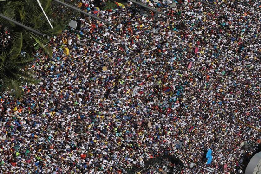 People attend a march against Nicolas Maduro's government in Caracas, Venezuela, on Feb. 2, 2019. Maduro and his chief opponent, National Assembly leader Juan Guaido, called on their supporters to take to the streets as international pressure increased on Maduro to resign. EPA-EFE/Miguel Gutierrez